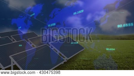 Multiple changing numbers over world map against solar panels on grass against blue sky. global finances and renewable energy concept