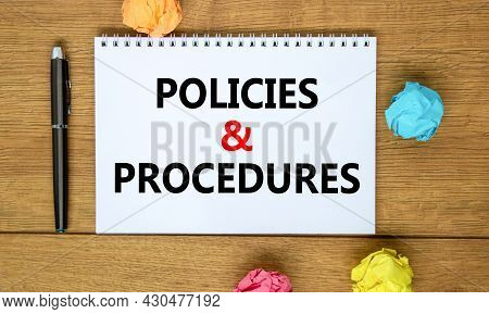 Policies And Procedures Symbol. Words 'policies And Procedures' On White Note On Beautiful Wooden Ta