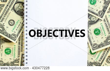 Objectives Symbol. The Concept Word 'objectives' On White Note. Beautiful Background From Dollar Bil