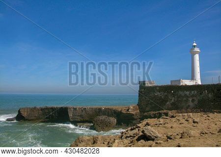 Austere Lighthouse Overlooking The Casablanca Coastline In Morocco.