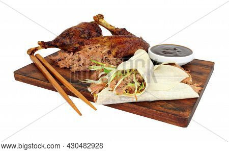 Aromatic Half Crispy Duck With Chinese Style Pancakes And Hoisin Sauce On A Wooden Board Isolated On