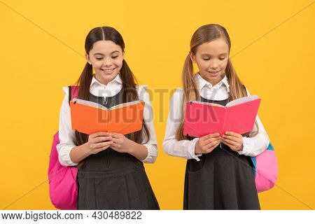 Little Children In School Uniforms Read Library Books Yellow Background, Reading