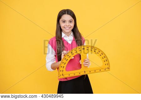 Educational Concept. Measurement. Happy Teenage Girl With Protractor. Back To School.