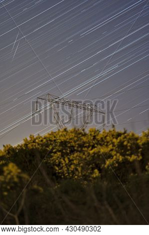 Beautiful Night View Of Falling Lyrid Meteors, Star Trails, Power Lines, Electric Transmission Pylon