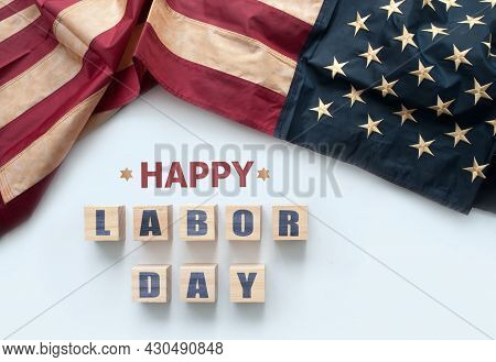 Happy Labor Day Printed On Wooden Blocks With Vintage American Flag