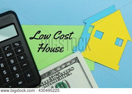 Calculator, Paper Money, Paper House, Colored Paper With The Word Low Cost House