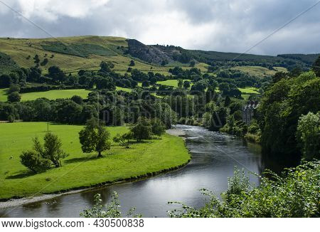 Dee River Valley, Wales. Beautiful Landscape View Of Idyllic Countryside. Green Fields And Hills Wit