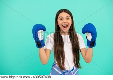 Surprised Teen Girl Boxer In Boxing Gloves During Sport Training, Sport Success