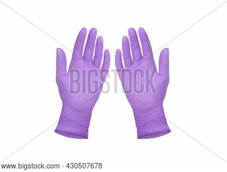 Medical Gloves. Two Purple Surgical Gloves Isolated On White Background With Hands. Rubber Glove Man