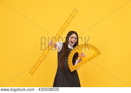 Emotional Child Hold Math Protractor And Ruler In School On Yellow Background, Education