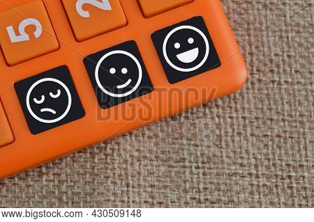 Calculator With Emotion Face. Customer Evaluation And Satisfaction Concept.