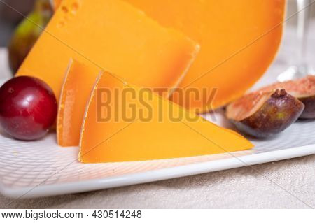 Cheese Collection, French Cheese Mimolette Made From Cow Milk Served With Fresh Figs