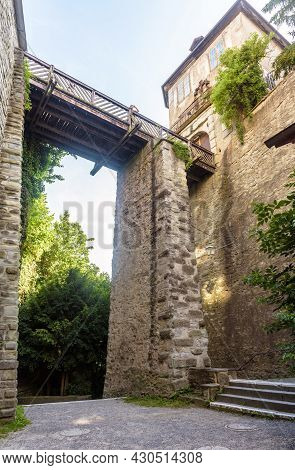 Old Wooden Bridge At Water Mill, Meersburg, Germany. Vertical View Of Tall Medieval Structure. This