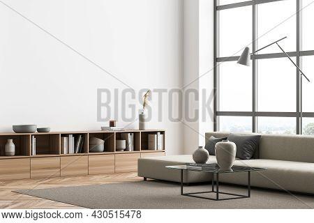 Corner Of The Minimalist Panoramic Beige Living Room Interior With Empty Wall, Sofa, Lamp, Coffee Ta