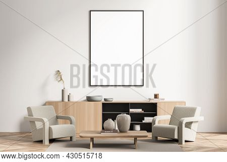 Mockup Canvas In The Waiting Room With Parquet Flooring. A Sideboard, A Coffee Table And Two Beige A