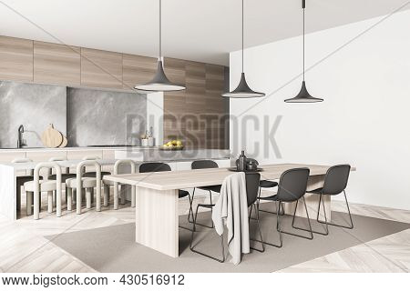 Corner View On Kitchen Room Interior With Dining Table, Twelve Chairs, Wooden Parquet Floor, Electri