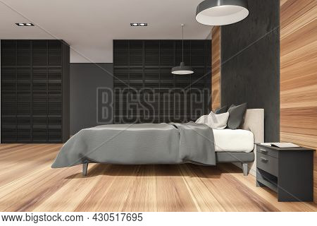 Stylish Bedroom Interior With Black Wall Partitions, A Bed With A Bedstand, Two Pendant Lamps And Wo