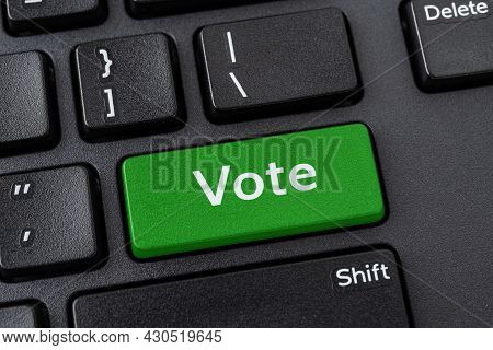 Vote Green Key On A Black Pc Keyboard. Online Participation In Elections, Internet Voting And E-voti
