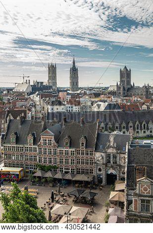 Gent, Flanders, Belgium - July 30, 2021: Aerial View On Sint Veerleplein With 3 Medieval Towers In B