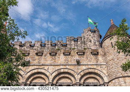 Gent, Flanders, Belgium - July 30, 2021: East Side Gray-brown Wall And Towers Of Medieval Gravenstee