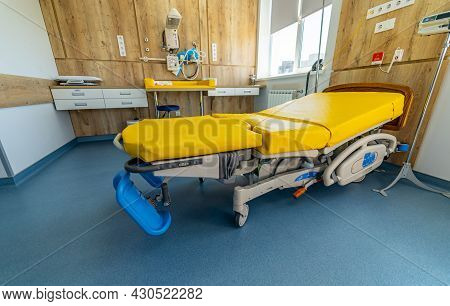 Empty Patient Beds In A Maternity Ward. Modern Light Ward Of Maternity Hospital. Yellow Bed. Stock P