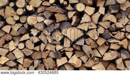 Chopped Firewood Of Fruit Trees. Pile Of Stacked Firewood Texture Background