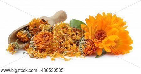 Pile Of Dry And Fresh Calendula Flowers With Wooden Scoop On White Background