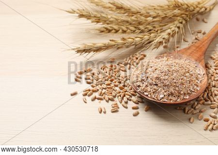 Wheat Bran, Kernels And Spikelets On Wooden Table, Closeup. Space For Text