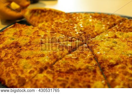 Detail Of A Large Family Pizza With Four Cheeses Such As Mozzarella Gorgonzola Parmesan And Ricotta