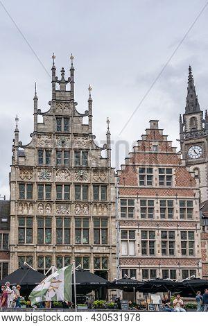 Gent, Flanders, Belgium - July 30, 2021: Medieval Facades Along Graslei Bordering Leie River. Talles