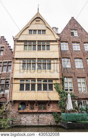 Gent, Flanders, Belgium - July 30, 2021: Last Remaining Beige Wooden Facade House Along Lieve River