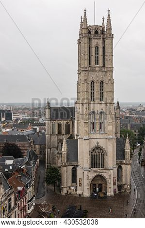 Gent, Flanders, Belgium - July 30, 2021: Closeup Of Tower Above Main Entrance Into Sint Baafs Cathed