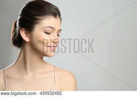 Beautiful Girl On Light Grey Background. Using Concealers And Foundation For Face Contouring