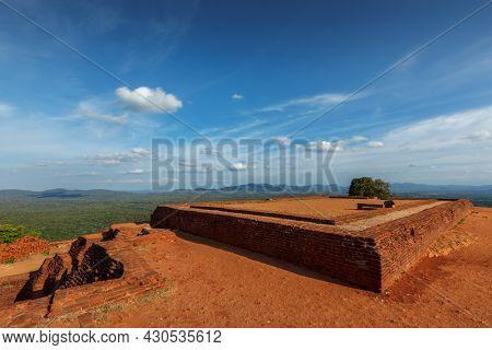 Famous tourist landmark of Sri Lanka - ancient Sigiriya rock (Lion rock) with palace fortress ruins on top in Sigiriya, Sri Lanka. UNESCO World Heritage Site