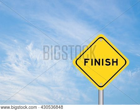 Yellow Transportation Sign With Word Finish On Blue Sky Background