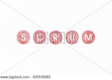Red Color Rubber Stamp In Word Scrum On White Paper Background