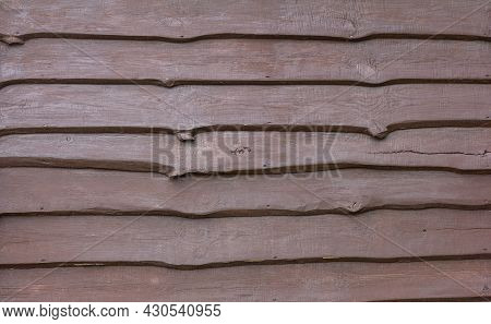 A Dark Wooden Background Made Of Rough Rough Boards, Nailed Overlapping