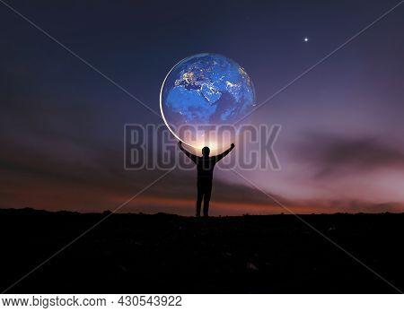 Earth In Human Hands. Earth Day. Energy Saving