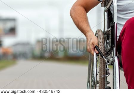 Close-up Of A Hand On A Wheelchair Wheel. The Concept Of A Wheelchair, Disabled Person, Full Life, P