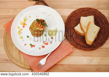 Vegetable barbeque fritters of zucchini served on a plate, flat lay top view