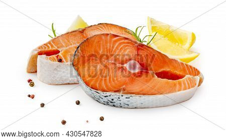 Salmon Steaks With Rosemary And Lemon On White Background. Salmon Pieces With Lemon Slices And Isola