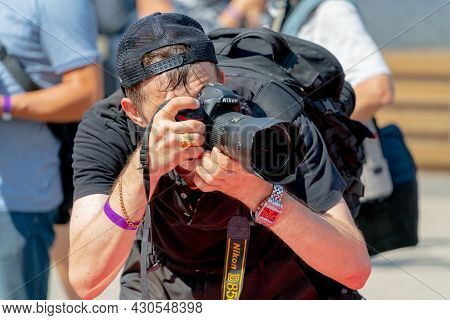 Moscow. Russia. August 14 2021. Photographer Holds A Camera With A Large Lens.