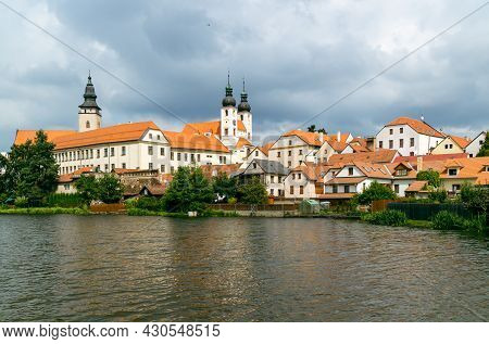View Of Telc City Panorama With Cloudy Sky Seen From The Surrounding River. The Historic Center Of T