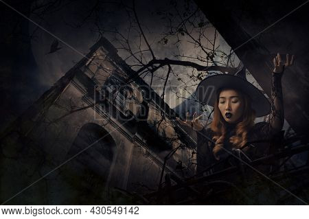 Mystery Halloween Witch Standing Over Grunge Castle, Dead Tree, Bird Fly, Full Moon And Cloudy Spook