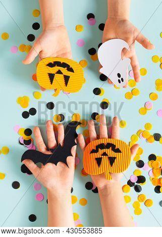 Kids Halloween Handmade Paper Pumpkins With Childrens Hands, Creative, Craft Concept On Blue Backgro