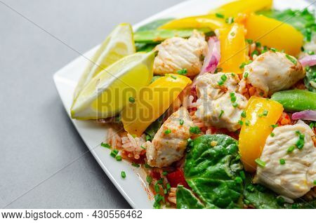 Cooked Chicken Breast Pieces With Peppers, Sugar Snap Peas, And Baby Leaf Spinach In A Spicy Sweet A