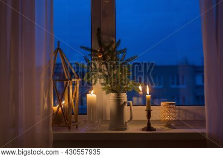 The Christmas Evening Windowsill With Burning Candles