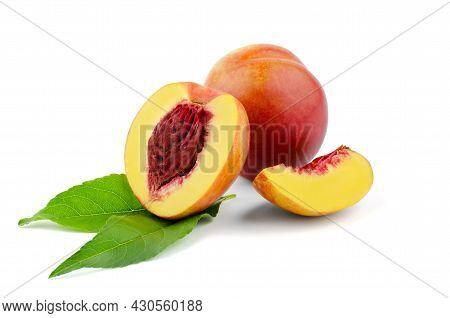 A Whole Peach, Half A Peach And A Peach Slice On A White Plate. Peach On A White Background, Isolate