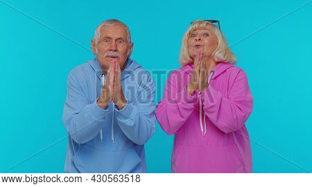 Please, God, Forgive Us. Senior Old Grandfather Grandmother Sincerely Praying To God And Looking Up