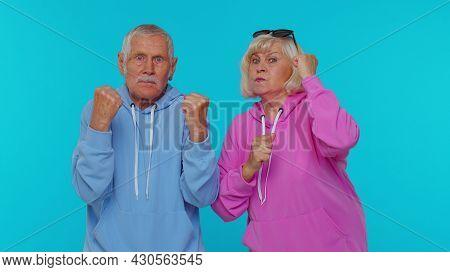 Quarrel. Displeased Senior Old Couple Man Woman Grandparents Gesturing Hands With Irritation And Dis
